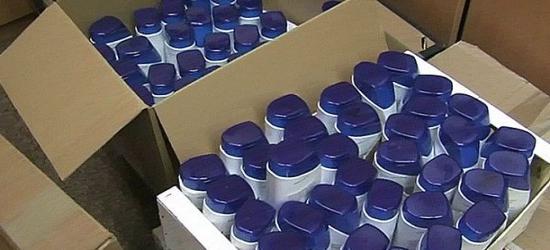 PODKARPACIE: Policjanci zabezpieczyli 56 tys. butelek podrobionego znanego szamponu przeciwłupieżowego (FILM, ZDJĘCIA)